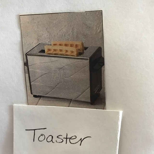Photo of real toaster holding two waffles