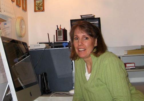 Woman sitting next to desk