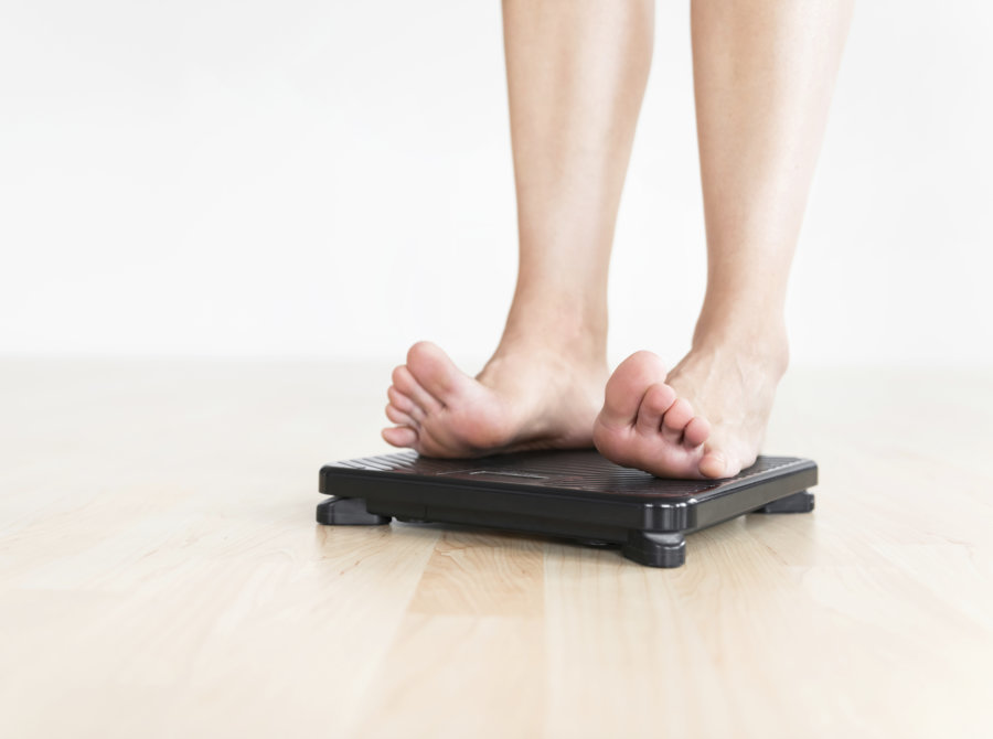 woman standing on weigher
